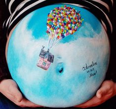 Baby bump painting by Carrie Preston-- I wonder if there's some sort of food-based paint you could make, that would be 100% safe on your skin?  Or you could use henna.