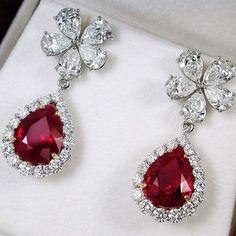 pigeon blood rubies and diamond earrings