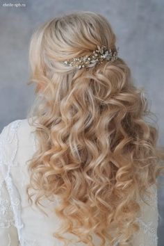 long wavy half up half down wedding hairstyle with pearl hairpiece