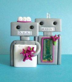 Google Image Result for http://manolobrides.com/images/2010/09/robot-wedding-cake-toppers.jpg