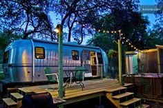 vintage airstream tiny house with deck conversion 001 600x400   Airstream Tiny House with Deck, Hot Tub, Fire Pit and Outdoor Shower