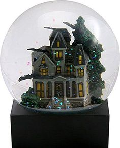 snow globes are enchanting and often times  hypnotic works of art. For this reason, they have found a special place in  my heart and home decor. One of my favorite charming yet whimsical cool  snow globes.      4.25 Inch Haunted House Water Globe with a Green Tree and Flying Bats