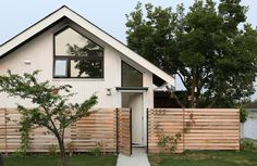 Magnolia Tree Lane House is a stylish new laneway house in Vancouver, built in the backyard of an existing house. It is named for the beautiful mature magnolia tree that was the centerpiece of the …