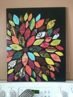 scrapbook paper cavas = awesome Now I know what to do with all those paper scraps!