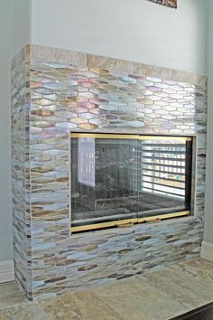 Fish scales mosaic tile fireplace design. Source: unknown.