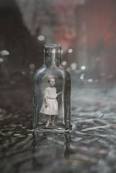 This young girl has been captured and put in a Bottle. It is believed that she was found playing in an alley in Seattle Washington. There may be other small people in the same location. Investigators are still searching. What else do you think was found?