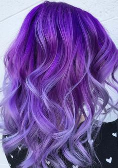 See here the gorgeous ideas of purple hair colors to use with long curls and waves in 2018. We've rounded up here the fresh purple hair colors with various shades to wear nowadays. We assure you these purple shades work with different hair colors. So, pick one of the best purple shade for you to get unique looks.