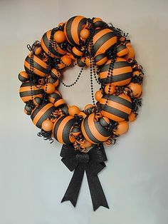 Fun wreath for Halloween  made with witch stockings and styrofoam balls