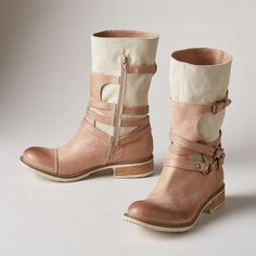 """LEGEND BOOTS--A sturdy, canvas shaft embraced by wraparound, leather straps sets these dynamic strappy canvas boots apart. Burnished leather. Decorative buckles and side zips. Italy. Exclusive. Euro whole sizes 36 to 41. 36 (US 6.75), 37 (US 7.5), 38 (US 8.25), 39 (US 9), 40 (US 9.75), 41 (US 10.5). 1"""" heel."""