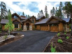 This stunning mountain lodge style plan bedroom has four suites; two masters on the main level and two more on the upper level. The plan is loaded with luxury features like built-in cabinetry and vaulted ceilings The kitchen, great room, dining room and m