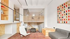 Architecture studio Mas-aqui has transformed an apartment in Barcelona into a multi-level home lined with wood and ceramic tiles. Concrete Retaining Walls, Exposed Concrete, Gaudi, Zones D'étude, Architecture Design, Pavilion Architecture, Japanese Architecture, Sustainable Architecture, Residential Architecture