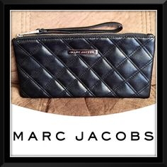 "Marc Jacobs Black Quilted Wristlet Clutch Bag! Marc Jacobs Black Quilted Wristlet Clutch Bag! Features: 100% authentic, ""MARC JACOBS"" plate on front, faux leather quilted design, top zipper pull, wristlet strap & black lining. Came with a perfume set. Like new, excellent condition! Measures 9 1/4"" x 4 1/2"" x 1/4"". Great size to hold cosmetics, cash, credit cards & phone (fits an iPhone 6+)... Marc Jacobs Bags"