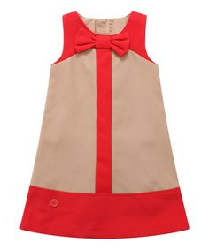 Soft lining and a shift silhouette give this frock a smooth fit, and the zipper in back ensures easy-peasy dressing.