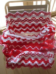 This is a gorgeous afghan.  Color block is given for this afghan on the blog spot.  Pattern is the crocheted ripple stitch.  Check out all her pictures of this afghan.