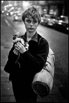 BRUCE DAVIDSON UK. London. 1960. Girl holding kitten.  Schneider / Bischofberger