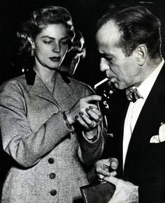 Actress Lauren Bacall lights a cigarette for her husband, actor Humphrey Bogart, at a press reception at London's Claridges Hotel, England, on April Hollywood Couples, Old Hollywood Movies, Golden Age Of Hollywood, Hollywood Stars, Classic Hollywood, Humphrey Bogart, Lauren Bacall, Bogie And Bacall, Actor Studio