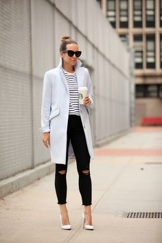 Horizontal stripes are a trend! Helena Glazer is wearing a simplistic yet stylish striped tee with high waisted black jeans and a pale blue overcoat. This look is easily achieved but gives the impression of instant glamour. Tee: Tag & Bone, Jeans: Express, Coat: H&M, Shoes: Manolo Blahnik.