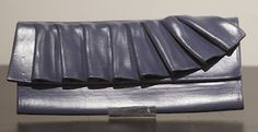 Blue ruffle clay wallet.
