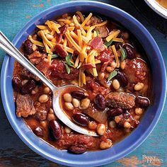 Satisfy your family with this hearty chili that includes bacon and beef. Top with cheese and cilantro for a delicious flavor twist. /