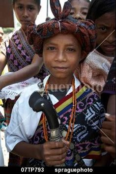 Boy wearing traditional dress including ikat weaves and beads,  Oecussi-Ambeno, East Timor stock photo