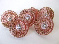 Hey, I found this really awesome Etsy listing at http://www.etsy.com/listing/112621710/vintage-rhinestone-buttons-pink-tinsel