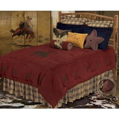 This cute #rusticbedding set features a whole lot of earthy red broken up by contrasting blues and a neutral plaid pattern #bedding #beddingsets #westernbedding    http://www.santaferanch.com/