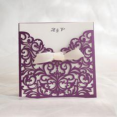 purple laser cut wedding invites with ivory ribbon