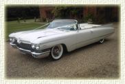 Keeping with the theme of old school glamour, how about turning up to your wedding in a vintage white 1960 Cadillac DeVille Convertible. You don't get more rock and roll than that and it would make for some great pictures!