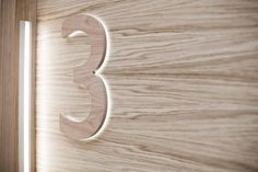 Wood with backlight for interior signs Signage Display, Retail Signage, Wayfinding Signage, Signage Design, Backlit Signage, Library Signage, Environmental Graphic Design, Environmental Graphics, Illuminated Signs