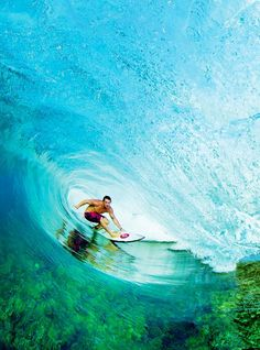 Aside from the beauty of this photo, I feel the opposing forces of the crashing wave, the gliding surfer, and the life beneath the wave.