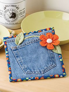 "A clever way to brighten you kitchen using a pretty hot pad made from jeans. Size 7 1/2"" x 8 1/2""."