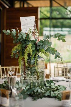 Botanical Centrepiece - Charlie Brear Payton Dress & Isere Skirt | Stylish Wedding at Broughton Hall in North Yorkshire | Greenery & Protea Flowers | Paul Joseph Photography.