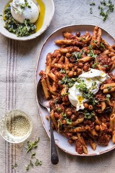 Easiest Tomato Basil Penne with Spicy Italian Chickpeas: This tomato basil sauce literally consist of two ingredients...canned tomatoes and basil pesto. So, so, so simple, but yet so delicious! @halfbakedharvest.com