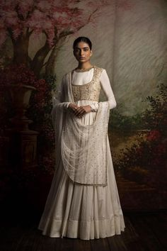 Sabyasachi is the one designer whose designs are being worn by in India and Pakistan. So if you want to wear a wedding dress go for Anarkali dresses designed by him Nikkah Dress, Pakistani Dresses, Indian Dresses, Indian Outfits, Ethnic Outfits, White Anarkali, Anarkali Dress, Lehenga Choli, Sharara