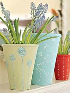 Paint designs on everyday terra-cotta gardening pots