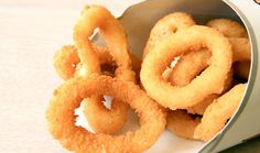 A copycat restaurant recipe for Burger King Onion Rings containing white onions, milk, flour, bread crumbs. Make it at home!