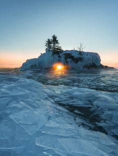 So glad I got up for this -15F sunrise. There's only a handful of days in the year where the morning light lines up perfectly with the hole in Hollow Rock. Grand Portage MN. [52876995] [OC]