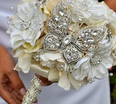Jeweled Butterfly bouquet. #BluePetyl #jeweledbouquet #bouquet #butterfly- For more ideas and inspiration like this, check out our website at www.theweddingbelle.net