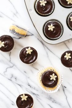 Things just taste better when they are mini... like these Marzipan Mini Cheesecakes with decadent chocolate ganache glaze.