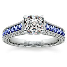 Antique Sapphire Gemstone Engagement Ring in Platinum Twenty eight graduated round cut sapphires are pave set in this exquisite antique floral gemstone setting in platinum, accenting your choice of center diamond. Beautiful floral detailing adorns the inside band. Proudly made in the USA.