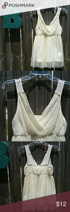"Beautiful Small Cream Romantic Boho Princess So comfortable as this is fully lined with jersey! Gorgeous pleated tulle on the bodice. Lace details in nice straps! No need for a complex bra with this one! Flattering babydoll fit;) 30"" under the arms unstretched,  24"" on the unstretched waist which easily stretches to 30"", and 24"" long from shoulder to the jersey hem. Perfect for a night out!   Brand and size tags have been removed.   Smoke and pet free! Bundle, make offers, and etc;) Xo Tops…"