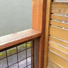 Wood and welded wire mesh fence.