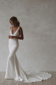 Archie is a sexy and sophisticated combination of both modern and classic. Made with seamless soft, double french crepe, her figure hugging design is created to completely celebrate every curve and turn of the body while draping dramatically with her signature cowl back. #felicitysbridalnz #weddingnz #bridenz #madewithlovebridal #mwlarchie French Crepes, Something Blue, Archie, News Design, Formal Dresses, Wedding Dresses, Cowl, Beautiful Dresses, Bride