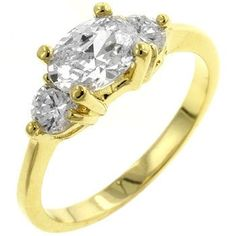 18k Gold Plated Triplet Engagement Ring with Clear Cubic Zirconia in a Prong Setting Polished into a Lustrous Goldtone Finish