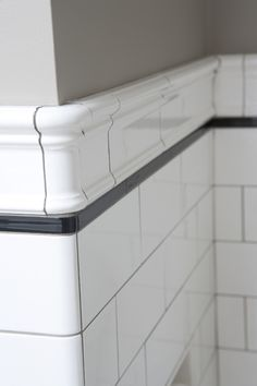 This classic vintage bathroom is enhanced by our Flat Edge White tile and black liner topped off with a classy Victoria Cap. This classic vintage bathroom is enhanced by our Flat Edge White tile and black liner topped off with a classy Victoria Cap. White Bathroom Interior, White Subway Tile Bathroom, Subway Tiles, White Tile Bathrooms, Tile On Bathroom Wall, Classic White Bathrooms, Bungalow Bathroom, Art Deco Bathroom, Classic Bathroom