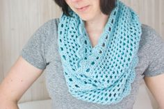This free crochet infinity scarf pattern is simple to execute and frames your face with pretty, feminine shell stitches.