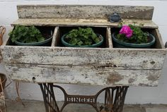 chicken coop planter on Singer sewing machine base @Red Wing Stoneware by Spompinato & Co..com @Andrea Lustgraaf