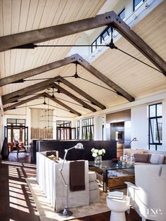 Chicago-based architect Kathryn Quinn designed a couple's Calistoga home to have an industrial feel inspired by the area's mining history. The project's builder, Eames Construction, fabricated the custom entry door out of reclaimed paulownia and steel. Steel Trusses, Roof Trusses, Exposed Trusses, Industrial Home Design, Industrial House, Industrial Stairs, Industrial Pipe, Industrial Apartment, Industrial Bedroom