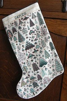 """""""Cranberry In Pines"""" pattern - to inspire my very own stocking (once I get around to it). Pixelated trees will match Stephen's snowflakes-and-space-invaders stocking, but I need to find something nerdy to throw in with the pines."""