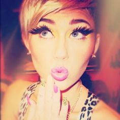 Miley Cyrus wearing leopard print and on nails as well.  Also fake eyelashes similar to butterfly wings.  MK ULTRA,  Monarch programming.